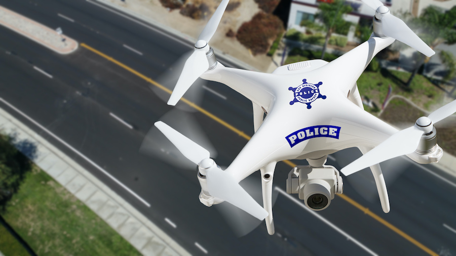 Police Unmanned Aircraft System, (UAS) Drone Flying Above A City Street.