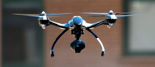 Remote ID: Flying Drones Over People and Moving Vehicles