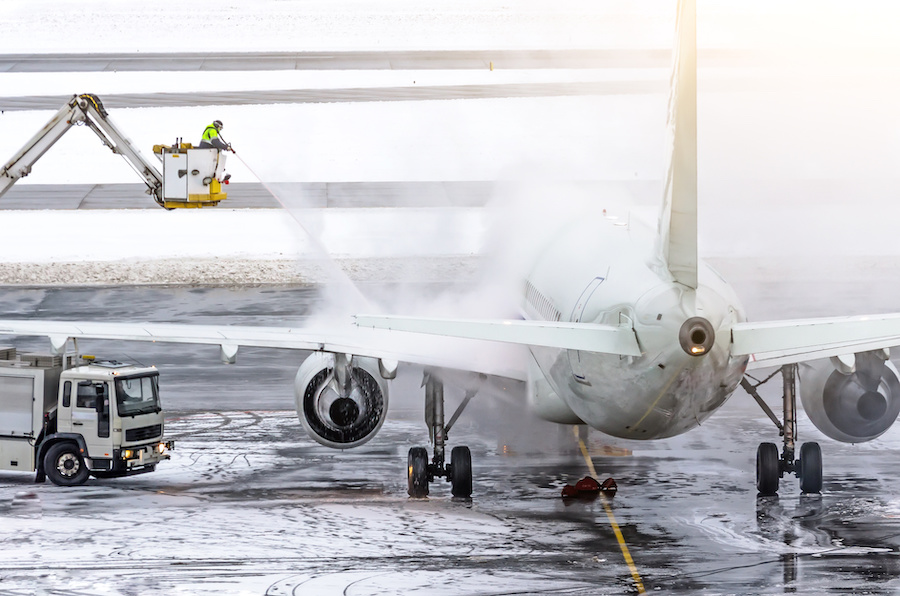 Ground crew provides de-icing. They are spraying the aircraft, which prevents the occurrence of frost.